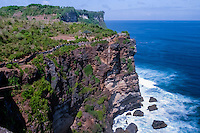 Bali, Badung, Uluwatu. Cliffs straight up from the ocean. Among the cliffs there are beaches famous for good surfing conditions.