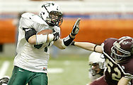Cornwall's Matt Moretto, left, carries the ball as Brad Comfort  during the Class A state championship game at the Carrier Dome in Syracuse on Nov. 24, 2006.
