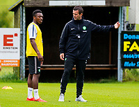 30/06/14<br /> CELTIC TRAINING<br /> AUSTRIA<br /> Celtic manager Ronny Deila (right) speaks with Darnell Fisher during training.