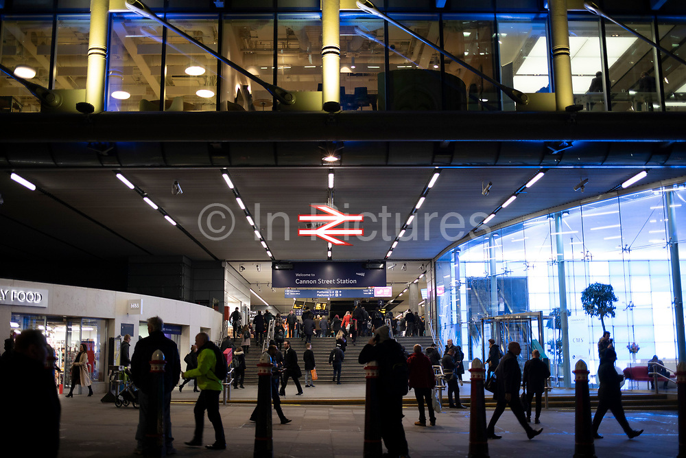 Modern glass offices at Canon Street station and the British Rail logo in the City of London on 27th November 2019 in London, England, United Kingdom. The British Rail double arrow logo is formed of two interlocked arrows showing the direction of travel on a double track railway and was nicknamed the arrow of indecision.