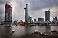 The Saigon skyline is ever changing with new construction. But there has been overbuilding of commercial and residential products, leaving banks with bad real estate loans. Robert Dodge, a Washington DC photographer and writer, has been working on his Vietnam 40 Years Later project since 2005. The project has taken him throughout Vietnam, including Hanoi, Ho Chi Minh City (Saigon), Nha Trang, Mue Nie, Phan Thiet, the Mekong, Sapa, Ninh Binh and the Perfume Pagoda. His images capture scenes and people from women in conical hats planting rice along the Red River in the north to men and women working in the floating markets on the Mekong River and its tributaries. Robert's project also captures the traditions of ancient Asia in the rural markets, Buddhist Monasteries and the celebrations around Tet, the Lunar New Year. Also to be found are images of the emerging modern Vietnam, such as young people eating and drinking and embracing the fashions and music of the West. His book. Vietnam 40 Years Later, was published March 2014 by Damiani Editore of Italy.