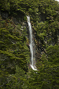 Scenic landscape with view of a waterfall on a steep cliff, Routeburn Track, South Island, New Zealand