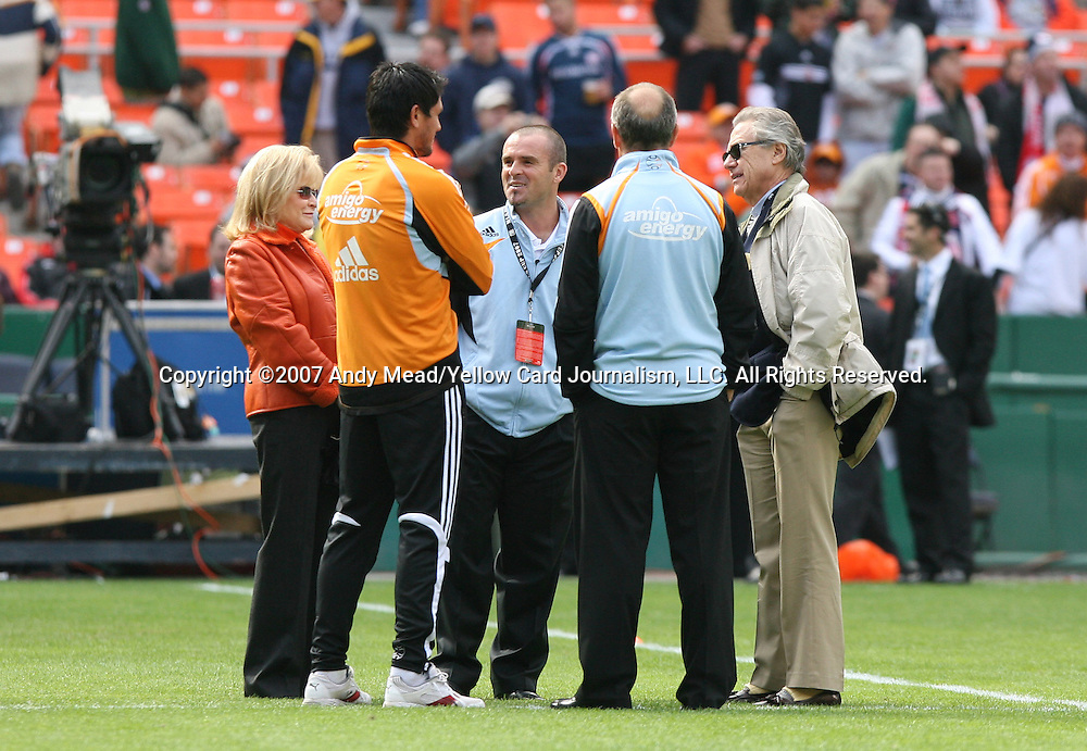 18 November 2007: Houston Dynamo owner Phil Anschutz (right) and his wife Nancy Anschutz (left) meet Houston head coach Dominic Kinnear (2nd from right), assistant coach John Spencer (center), and injured player Brian Ching (2nd from left). The Houston Dynamo defeated the New England Revolution 2-1 at RFK Stadium in Washington, DC in MLS Cup 2007, Major League Soccer's championship game.