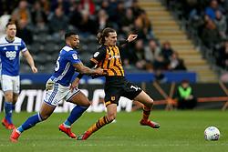 Birmingham City's David Davis (centre) tackles Hull City's Jackson Irvine