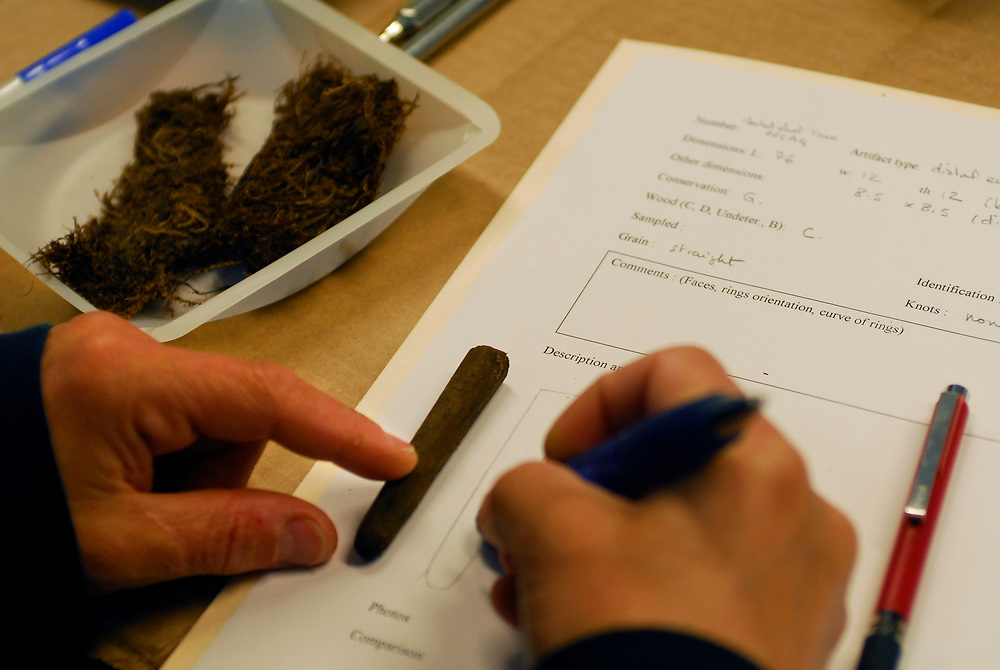 Alaska, Barrow. Archaeologist Claire Alix works on some wood chips and wood artifacts on the lab of the Barrow Global Climate Change Research Facility.  July 2007