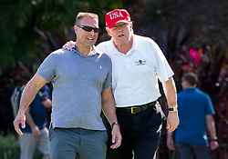 December 29, 2017 - Florida, U.S. - President DONALD TRUMP welcomes commanding officer GENE GIBSON and other U.S. Coast Guard Station Lake Worth members to a tournament and lunch at the Trump International Golf Club. (Credit Image: © Richard Graulich/The Palm Beach Post via ZUMA Wire)