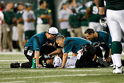 Philadelphia Eagles Trainer Rick Burkholder attends to a player on the field during the NFL game between the Philadelphia Eagles and the New York Jets on September 3rd 2009. At Giants Stadium in East Rutherford, NJ.  (Photo By Brian Garfinkel)