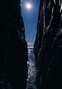 Wave-carved slot in Canadian Shield Rock, Lake Superior shore near the Agawa River, Lake Superior Provincial Park, Ontario, Canada.