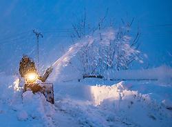 THEMENBILD - Mann mit einer Schneefräse bei der Schneeräumung seiner Hauseinfahrt in Oberpeischlach, aufgenommen am Samstag, 5. Dezember 2020, in Osttirol. Der Winter macht sich in Teilen Österreichs mit enormen Schnee- und Regenmengen bemerkbar. In Osttirol und Oberkärnten ist von Freitag auf Samstag die Schneedecke um rund 50 bis 70 Zentimeter gewachsen. Mancherorts herrschte rote und damit höchste Wetterwarnung // Mann mit einer Schneefräse bei der Schneeräumung seiner Hauseinfahrt, taken on Saturday, December 5, 2020, in East Tyrol. The winter is making itself felt in parts of Austria with enormous amounts of snow and rain. In East Tyrol and Upper Carinthia, the snow cover has grown by about 50 to 70 centimeters from Friday to Saturday. In some places there were red and therefore highest weather warnings. EXPA Pictures © 2020, PhotoCredit: EXPA/ Johann Groder
