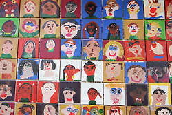 Wall display of portraits painted by primary school pupils,