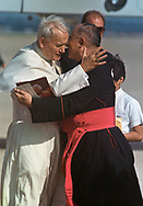 Pope John Paul II made his historic tour to the United States, September 10-18, 1987, visiting Miami, Florida; Columbia, SC; New Orleans, LA; San Antonio, TX, Phoenix, AZ, Los Angeles, CA; Monterrey, CA, San Francisco, CA, and Detroit, MI. <br /> <br /> Pope John Paul II is greeted by Bishop Thomas J. O'Brien  as he arrives in Phoenix, AZ, September 14, 1987.