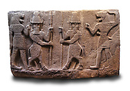 Picture of Neo-Hittite orthostat describing the legend of Gilgamesh from Karkamis,, Turkey. Ancora Archaeological Museum. Mythological scene. The 2 figures in the center are flanked by lion headed men who have one fist outstretched and are known as Ugallu. The 2 figures in the middle holding spears are men with bodies of bulls known as Kusarikku. 4