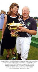MR & MRS URS SCHWARZENBACH he is the Swiss multi-millionaire, at a polo match in West Sussex on 21st July 2002.PCE 341