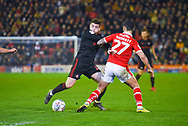 Lynden Gooch of Sunderland (11) tries to get past Alex Mowatt of Barnsley (27) during the EFL Sky Bet League 1 match between Barnsley and Sunderland at Oakwell, Barnsley, England on 12 March 2019.