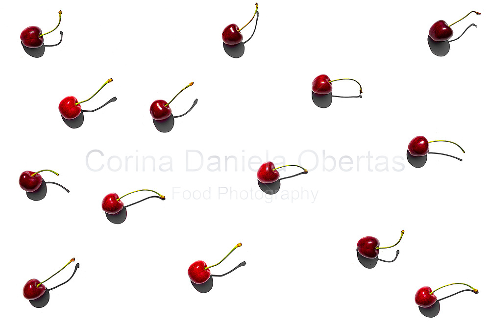 Cherries with long shadow on white background - Flat lay<br /> EXCLUSIVE ONLY ON THIS SITE!
