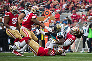 The San Francisco 49ers tackle Jacksonville Jaguars running back Leonard Fournette (27) at Levi's Stadium in Santa Clara, Calif., on December 24, 2017. (Stan Olszewski/Special to S.F. Examiner)