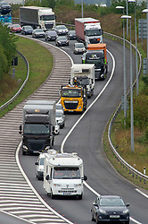 ©Licensed to London News Pictures 27/08/2020 Dartford,UK. A large campervan coming off the A2 slip to join the M25. The big August bank holiday staycation getaway has started early today on the M25 motorway in Dartford, Kent. Traffic near the Dartford crossing is at a near standstill anti clock-wise this afternoon as bank holiday travellers look to beat the travel chaos with 18 million cars expected on the roads this weekend as well as rail cancellations due to engineering works causing delays. Photo credit: Grant Falvey/LNP