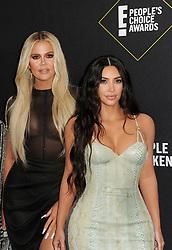 Kim Kardashian and Khloe Kardashian at the 2019 E! People's Choice Awards held at the Barker Hangar in Santa Monica, USA on November 10, 2019.