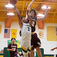 Thoreau Hawk Cordell Platero (3) drives to the basket as Rehoboth Lynx Jake Zylstra (32) defends Tuesday, Jan. 7 at Thoreau High School in Thoreau.