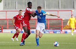 Ethan Hamilton of Peterborough United in action with Tariq Uwakwe of Accrington Stanley - Mandatory by-line: Joe Dent/JMP - 12/09/2020 - FOOTBALL - Wham Stadium - Accrington, England - Accrington Stanley v Peterborough United - Sky Bet League One