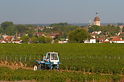 tractor in the vineyard beaune town in the distance vineyard beaune cote de beaune burgundy france