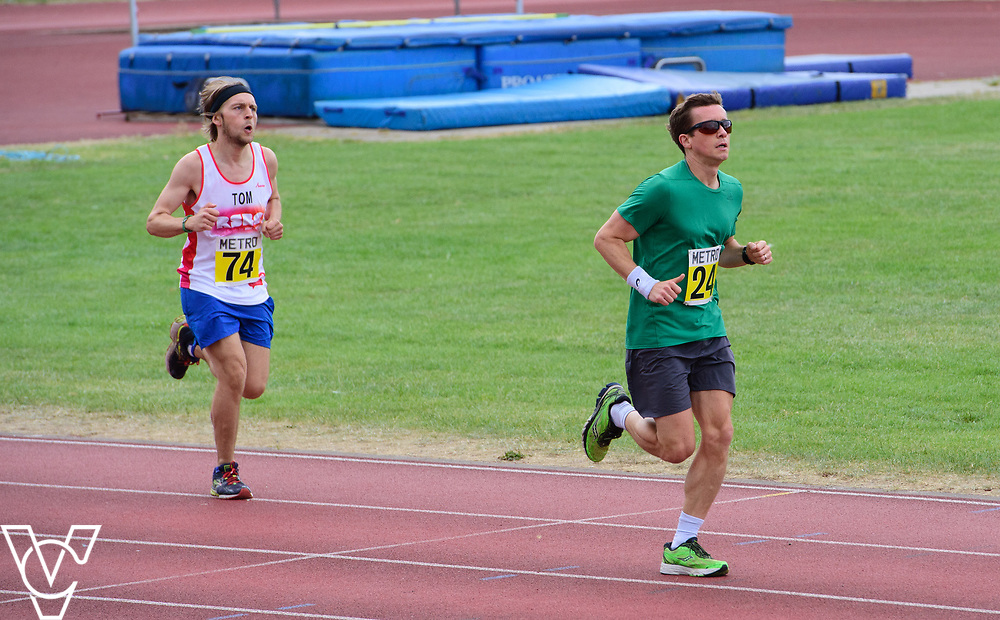 Event: 5000 meter relay<br /> Competitors, from left: Competitor #74 and Rhys Jones<br /> <br /> Metro Blind Sport's 42nd Athletics Open, held at Mile End Stadium, Tower Hamlets, London.<br /> <br /> Picture: Chris Vaughan Photography for Metro Blind Sports<br /> Date: June 16, 2018