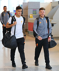 Phillipe Courtinho and Alberto Moreno and The Liverpool Football Team fly out of Manchester Airport to Hong Kong on Sunday morning.