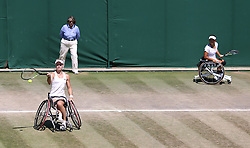 Diede De Groot and Yui Kamiji during the Ladies' Wheelchair Doubles Final on day thirteen of the Wimbledon Championships at the All England Lawn Tennis and Croquet Club, Wimbledon. PRESS ASSOCIATION Photo. Picture date: Sunday July 15, 2018. See PA story TENNIS Wimbledon. Photo credit should read: Steven Paston/PA Wire. RESTRICTIONS: Editorial use only. No commercial use without prior written consent of the AELTC. Still image use only - no moving images to emulate broadcast. No superimposing or removal of sponsor/ad logos. Call +44 (0)1158 447447 for further information.