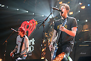 MICHAEL CLIFFORD and LUKE HEMMINGS of 5 Seconds of Summer perform at the Hot 99.5 Jingle Ball at the Verizon Center in Washington, D.C.