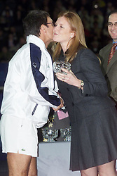 File photo dated 20/2/2000 of singer Sir Cliff Richard, who has won his legal action against the BBC over coverage of a police raid at his apartment in Berkshire in August 2014, gives the Duchess of York, Sarah Ferguson, a kiss on the cheek as she awards the team captain the trophy for winning the celebrity charity tennis tournament, the York Charity cup, at the London Arena, Docklands.