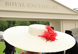 A Racegoer outside the Royal Enclosure during day one of Royal Ascot at Ascot Racecourse. PRESS ASSOCIATION Photo. Picture date: Tuesday June 19, 2018. See PA story RACING Ascot. Photo credit should read: Nigel French/PA Wire. RESTRICTIONS: Use subject to restrictions. Editorial use only, no commercial or promotional use. No private sales.