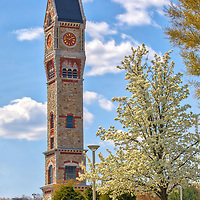 Spring colors and tree blossom at the historic Worcester State Hospital clock tower located Worcester Massachusetts.<br /> <br /> Worcester Memorial Clock Tower photography images are available as museum quality photography prints, canvas prints, acrylic prints, wood prints or metal prints. Fine art prints may be framed and matted to the individual liking and interior design decorating needs.<br /> <br /> Good light and happy photo making!<br /> <br /> My best,<br /> <br /> Juergen