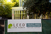 LEEd home construction sign in Los Angeles. LEED certification is based on a rating system for green buildings set by the U.S. Green Building Council, points are achieved by effective use of sustainable materials, water efficiency, indoor air quality and energy efficiency in the construction. home construction sign in Los Angeles. LEED certification is based on a rating system for green buildings set by the U.S. Green Building Council, points are achieved by effective use of sustainable materials, water efficiency, indoor air quality and energy efficiency in the construction.