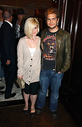 KELLY OSBOURNE and JACK OSBOURNE at a party to celebrate the opening of The Bar at The Dorchester, Park Lane, London on 27th June 2006.<br /><br />NON EXCLUSIVE - WORLD RIGHTS