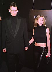 COUNT SEBASTIAN RHODES-STAMPA and model PAULA HAMILTON, at a party in London on 26th February 1998.MFU 65
