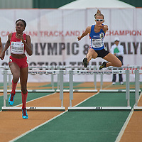 Xahria Santiago clears the final hurdle and then goes on to win the Junior Women's 400m Hurdle dash at the Athletics Canada National Championships.