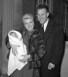 File photo dated 29/11/1962 of Bruce Forsyth escorting his wife, Penny, and their new baby, Laura, from the London clinic in Marylebone, London. The veteran entertainer has died aged 89