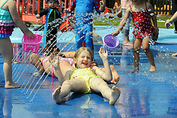© Licensed to London News Pictures. 05/07/2013<br /> Hot weather in Kent today (05.07.2013) as this weekend looks set to be the start of a heatwave across the UK.<br /> Children and adults enjoying the hot weather at Swanley Park in Swanley,Kent. <br /> Photo credit :Grant Falvey/LNP
