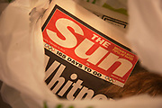 "The Sun newspaper in a shopping bag in London, England, UK. British police arrested five senior members of staff at News Corporation's newspaper The Sun, as part of investigations into alleged payments to police by journalists for information. This story continues the controversy surrounding News International with regards to the phone hacking scandal. Trevor Kavanagh, the newspapers's associate editor said the senior members of staff had been treated like ""an organised gang"" and the tabloid was ""not a swamp that needed draining"". He said money sometimes changed hands while unearthing stories, and this had always been standard practice. The Met Police declined to comment."