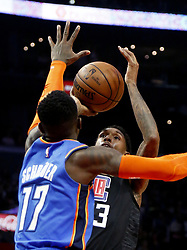 March 8, 2019 - Los Angeles, California, U.S - Los Angeles Clippers' Lou Williams (23) shoots over Oklahoma City Thunder's Dennis Schroder (17) during an NBA basketball game between Los Angeles Clippers and Oklahoma City Thunder Friday, March 8, 2019, in Los Angeles. (Credit Image: © Ringo Chiu/ZUMA Wire)