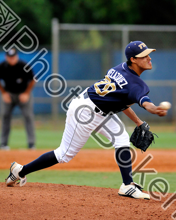 2011 May 20 - FIU Jose Velazquez (20) pitching sidearm. Florida International University baseball fell to Florida Atlantic University, 2-0, at FIU Baseball Stadium, Miami, Florida. (Photo by: www.photobokeh.com / Alex J. Hernandez)