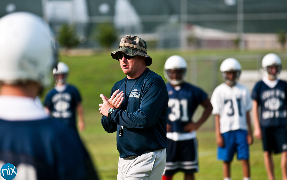 Hickory Ridge head coach Marty Paxton works with his team during football practice Monday, July 30 at Hickory Ridge High School in Harrisburg. (photo by James Nix)