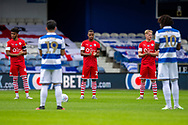 Queens Park Rangers and Barnsley players clap for a minute before the EFL Sky Bet Championship match between Queens Park Rangers and Barnsley at the Kiyan Prince Foundation Stadium, London, England on 20 June 2020.
