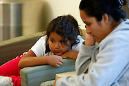 Fernanda Garcia-Villanueva, 8, (L) waits with her mother Areli Villanueva for a counseling session as part of the Shapedown Program at The Children's Hospital in Aurora, Colorado July 8, 2010.  Shapedown is part of the child and teen weight management programs at the hospital.  REUTERS/Rick Wilking (UNITED STATES)