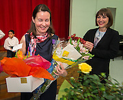 Claire Frazier, left, is showered with gifts after being awarded the Chevalier dans Ordre des Palmes Academiques by France Cultural Attache Sylvie Christophe, right, at Kolter Elementary School, November 20, 2013.