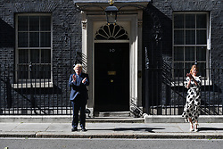 © Licensed to London News Pictures. 05/07/2020. London, UK. Clap for Carers founder AnneMarie Plas and British Prime Minister Boris Johnson clap outside Downing St to mark the 72nd anniversary and to thank staff for their work in tackling the coronavirus pandemic. Photo credit: Ray Tang/LNP