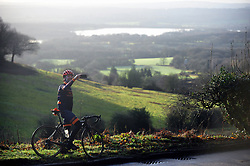 © Licensed to London News Pictures.26/12/2017.<br /> Ide Hill, UK.<br /> Boxing day cyclist takes a selfie phone break at the top of  Ide Hill near Sundridge over looking Bough Beech Reservoir, Kent.<br /> Photo credit: Grant Falvey/LNP