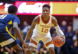 Feb 9, 2019; Morgantown, WV, USA; Texas Longhorns guard Kerwin Roach II (12) dribbles during the first half against the West Virginia Mountaineers at WVU Coliseum. Mandatory Credit: Ben Queen-USA TODAY Sports