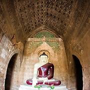 BAGAN, MYANMAR--Dating to the reign of Narathihapate (1256-1287), Tayok Pye Temple is located on the eastern side of the plain of Bagan near Minnanthu. Of particular note are intricate renovated stucco work and decorative paintings on the interior walls. It is also one of the handful of temples that are open to climbing onto upper terraces.