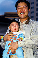 Korean father with five month old baby boy, Chogyesa Temple, Seoul, South Korea